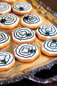 To conjure up a devilish-looking dessert, frost slice-and-bake sugar cookies with white royal icing. Then, starting at the cookie's center, pipe circles of black icing; create cobwebs by alternately dragging a toothpick from the center to the edge, and from the edge to the center.