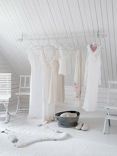 I dream of an all white walk in closet, with fluffy white carpet and white angled walls, a white vanity and all of my clothes perfectly organized. LOVE this.