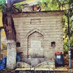 The fount of Tsinari is one of the best preserved of Thessaloniki, with a piece of ancient lettering standing out on the bottom. (Walking Thessaloniki / Route Ano Poli b) Thessaloniki, Walking, Outdoor Structures, Lettering, Plants, Woking, Drawing Letters, Planters, Texting