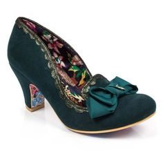 <p>Make this elegant pair your shoe BFF this season! Comfortable, perfect, and always there to make you smile. Featuring a soft to the touch upper and heel with metallic scallop edging and a grosgrain bow with charm.</p> <ul> <li>Mid heel</li> <li>Grosgrain bow</li> <li>IC charm</li> </ul>