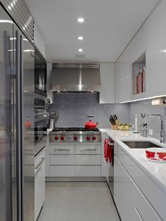 Red touches in a neutral kitchen--of course I love it! --Modern Apartment NYC - contemporary - kitchen - new york - Michel Arnaud Galley Kitchen Design, Small Galley Kitchens, Galley Kitchen Remodel, Modern Kitchen Design, Home Kitchens, Kitchen Small, Kitchen Designs, Wolf Kitchen, Kitchen White