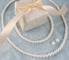 All ladies (excluding bride) wear pearl studs and pearl necklace and bracelet