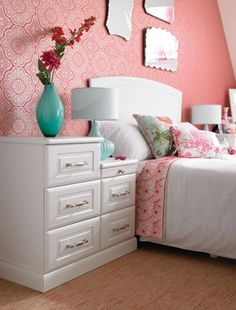 Pink doesn't have to just be bubblegum, baby or magenta! Have a look at coral pink if you want something subtle yet striking in your bedroom colour scheme. Mix it with smart white furniture to really make it stand out. Rialto bedroom design by Hammonds.