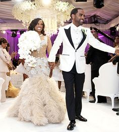 Kandi Burruss, the Real Housewives of Atlanta reality star, married Todd Tucker in April 2014. The wedding was white everything--ceiling draping, lounge furniture, flowers, chandelier, carpet, etc.