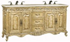 Antiqued crackle parchment finish with aged silver highlights, an Ivory Cream marble top and numerous embellishments.    www.mkhomedesign.com