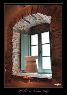 Interior window of an art pottery store in Halki village.
