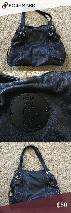 Juicy Couture Purse Used, soft matte black leather exterior, silver hardware, and satin red interior. Good condition, bottom of interior of bag has signs of wear. Smoke free home. Love all the pockets and get tons of compliments! Juicy Couture Bags Totes
