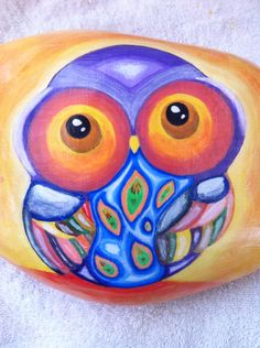 Owl hand painted stone.