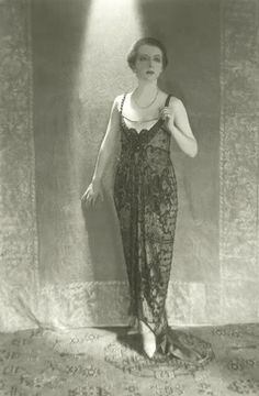 c.1919 Baron de Meyer ,Actress Clare Eames   Actress Clare Eames wearing a sleeveless beaded dress in black net with a satin foundation, by Frances, standing in front of an embroidered drapery.