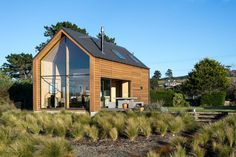 """This New Zealand """"bach"""" (a simple vacation home) has a 592 sq ft main level plus two attic loft bedrooms.   Tiny Homes"""