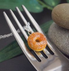 These cute doughnut / donut is handmade from polymer clay and are about 1.40 cm in diameter with sugar raise.  It is attached to a 28inches sterling silver chain with lobster clasp.  Donut size about 1.4cm.  Due to the handmade nature of this item it should be treated with care, and the one...