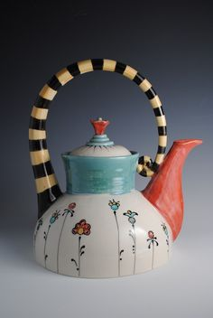 Teapot with color blocking, stripes and patterns Too cute! Wonder if I could do this at paint your own pottery?