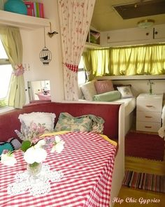 The classic vintage colors and patterns make this trailer so inviting. The gingham tablecloth and floral curtains are a great mix of pattern.