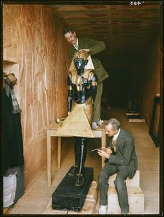 """The discovery of Tutankhamun in color pictures, a """"laboratory"""" set up in the tomb of Sethos II, conservators Arthur Mace and Alfred Lucas clean one of the sentinel statues from the antechamber. Ancient Egyptian Art, Ancient Aliens, Ancient History, European History, Ancient Greece, Egyptian Mythology, Egyptian Symbols, Egyptian Goddess, The Boy King"""