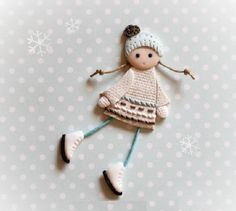 A Snow-maiden. Brooch. Made of polymer clay in the author's technique of patchwork modeling