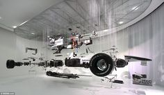 Deconstructed: Mercedes' 2010 Formula 1 car - seen here in all its glory - is stripped down and suspended on wire at the exhibition in Weybridge, Surrey.  Dutch artist Paul Veroude won the permission of Mercedes team boss Nick Fry to take the vehicle apart