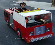 Homemade Fire Truck for Fire Fighter Costume: My son got a battery-powered 4 wheeler for his birthday last year, so this Halloween we decided to turn it into a fire truck so he could drive it in our