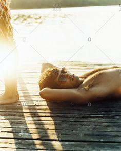 A young man sunbathing