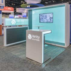Exhibitor: Verity Solutions Group Inc. Design: Exhibits Northwest Fabrication: Classic Exhibits Inc. System: Classic Exhibits Inc. Photo: F-stop Photography Led Furniture, Furniture Design, Curved Reception Desk, Exibition Design, Web Banner Design, Design Web, Design Trends, Print Advertising, Advertising Campaign