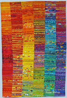 Susan Rienzo.  Title: AUGUST DAZE This colorful art quilt is one in my abstract series of using raw edged strips in a linear design. I freely hand cut my fabrics by color with pinking shears. I stitch raw edged strips onto different colored backgrounds intuitively, to create a visual feast of