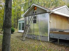 remodeling a manufactured home Adding foamboard insulation to the outside of a mobile home Mobile Home Siding, Mobile Home Redo, Mobile Home Exteriors, Mobile Home Repair, Mobile Home Renovations, Mobile Home Makeovers, Mobile Home Decorating, Home Remodeling Diy, Remodeling Mobile Homes