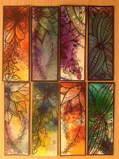 Zentangled bookmarks drawn on hand painted paper