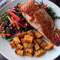 Salmon with sweet potatoes and a salad