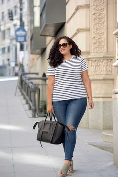 Tanesha Awasthi (formerly Girl With Curves) wearing a stripe tee, skinny jeans and wedge sandals in Seattle