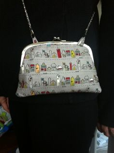 So pleased with my Yummy Mummy (and Daughter) purse.  Only took 2-3 hours to make.  Holds iPhone in one side and cards/cash/lippy in other side.  I added the loops and chain so I could wear it across the body - ideal when shopping.