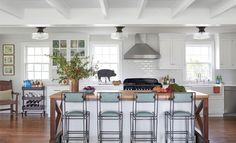 Pops of blue spatterware add a few more classically country elements to this Tennessee farmhouse's kitchen.
