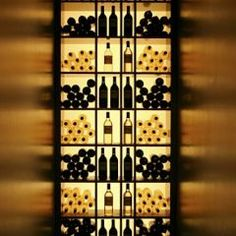 Robert Granoff.  Beautifully back-lit wine cellar with spectacular play of light on the walls.
