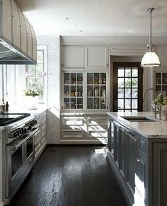 Love the look of a two toned kitchen- love the dark floors