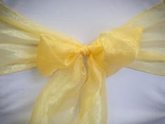 Chair Rentals- Yellow Organza Chair Sash. Complete the look with a matching table runner or napkin. Check out our other fabrics at Eventrentalutah.com or follow our board on Pinterest
