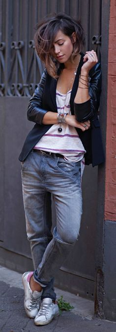 Zoé Alalouch oozes tomboy chic in a pair of vintage denim jeans and a black blazer.  Jeans: Diesel, Top: Urban Outfitters, Sneakers: Golden Goose.