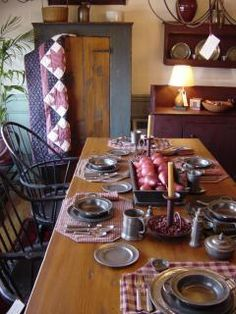 Handcrafted furniture, colonial reproductions, 18th and 19th century furniture, Windsor chairs, farm tables, pewter, quilts, period art, Old World Pewter and Wisconsin pottery, oriental carpets, cupboards, highboys, lowboys, drop leaf tables.