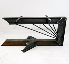 Cantilevered Steel I-Beam table legs. Industrial modern metal coffee table base.