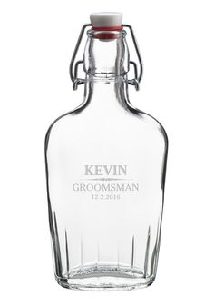 "This 8"" glass flask is a classic and memorable gift for your groomsmen. It holds 8.5 oz of liquid. It may be personalized with 3 lines of text."