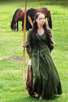 "The dress reminds me of Susan Pevensie's dress on ""The Lion, the Witch, and the Wardrobe.""  I've always loved that dress!"
