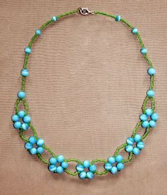 Free pattern for beaded necklace Blue Flowers Click on link to get pattern - http://beadsmagic.com/?p=5554