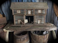 Sweet Liberty Homestead primitive log cabin on etsy. 2 story dogtrot with breezeway, chopping block with handmade axe, clothesline and hand carved bench. So primitive!