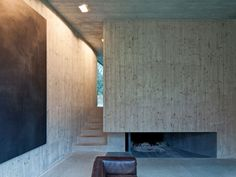 Schneider & Schneider has built this stunning but somewhat austere house. The black cube is simple in structure but precise. The concrete interior structure