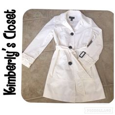 ✨WHITE TRENCH COAT✨ White Style & Co. lightweight trench raincoat with black buttons and black buckles on sleeves.  Shell:  55% cotton, 45% nylon.  Lining:  100% polyester.  Washable.  Purchased from Macy's.  There is a very faint yellowing around the inside of the collar (almost unnoticeable - see last picture) otherwise in great condition!  Only worn a few times. Style & Co Jackets & Coats Trench Coats
