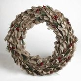 Found it at Wayfair - Chalet Berry Wreath - Think I might try something like this with burlap.