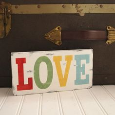 Love sign. Handpainted wood.