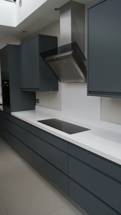 Graphite grey modern kitchen with White Silestone work tops, designed and fitted… Modern Grey Kitchen, Grey Kitchen Designs, Gray And White Kitchen, Modern Kitchen Interiors, Kitchen Room Design, Grey Kitchens, Modern Kitchen Design, Interior Design Kitchen, Kitchen Nook