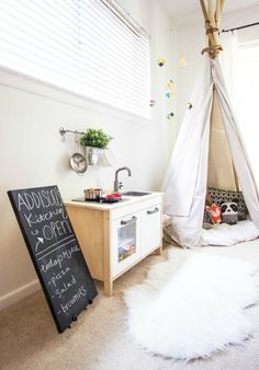 """Love the little kitchen for when the baby gets older! Adorable with a chalk board, so she can have a """"restaurant"""""""