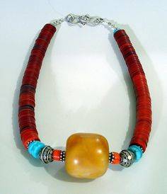 It took a long time for this necklace to come together.  My friend Jeanne gave me the amber after her husband died.  I got the coral, turquoise and Balinese beads at an outside art show in Portland...