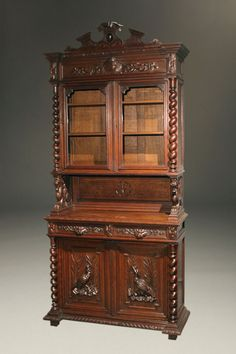 19th century French Buffet du Corps in hand carved oak featuring game scene on doors and rope twist columns, circa 1870. #antique #cupboards