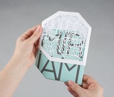 This is an innovative envelope packaging design that has utilised a package design that involves die-cuts and transparent material, to hold and protect the card. This is an interesting pack design as you are able to see the sophisticated design of the postcard, through the package design, which engages the viewer encourages them to pick up the postcard, and purchase it.