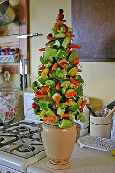 Want a healthy appetizer for the holidays?  Create this edible Christmas tree with a foam cone, a pot, skewers or toothpicks and veggies